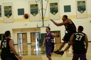 Soldiers' Ron Holloway drives and dishes to the open man for one of his 7 assists